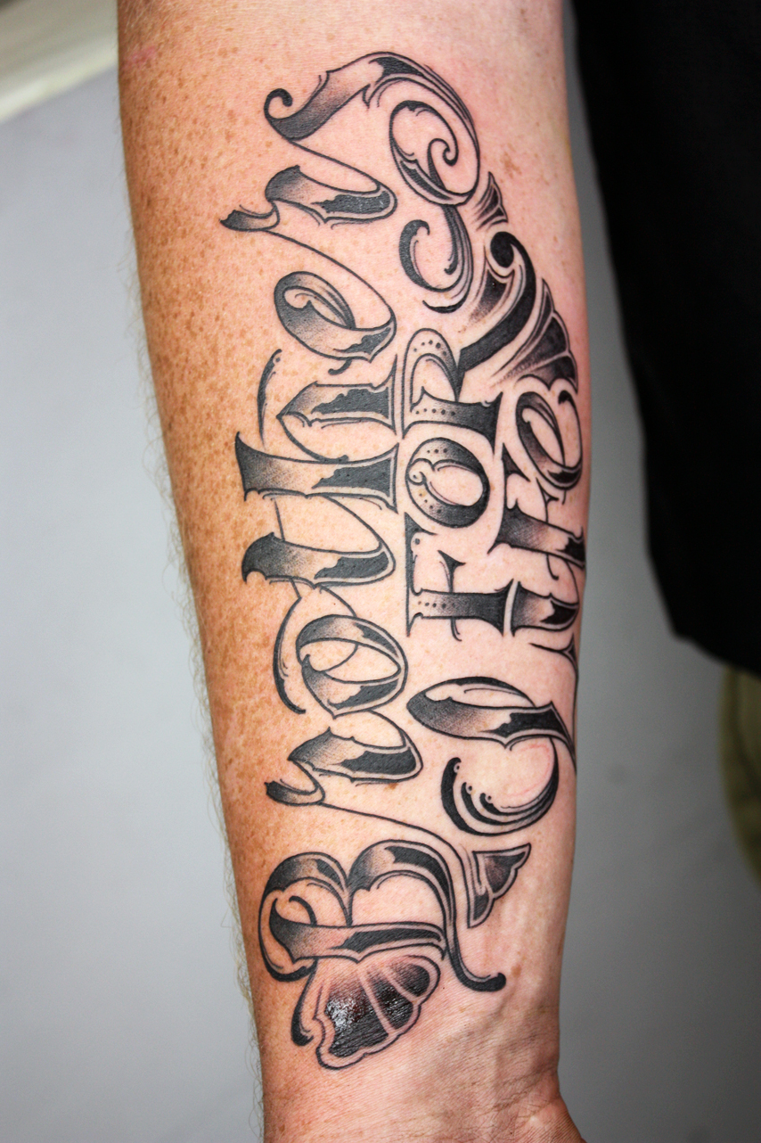 Brothers for life writing on the forearm