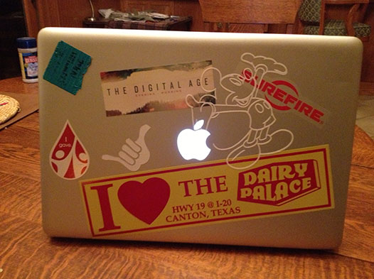 Photo of a laptop witha DP bumper sticker stuck to it