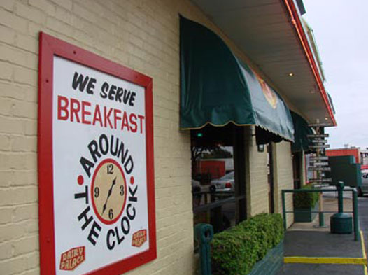Photo of a sign that says We Serve Breakfast Around The Clock