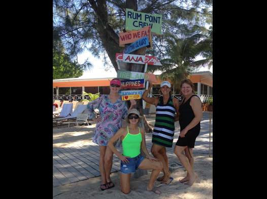 Photo of people on Jamaican resort holding DP bumper sticker