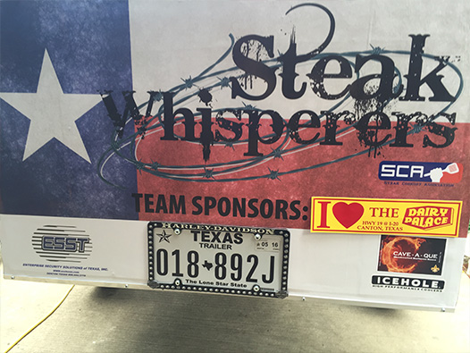 Photo of a DP bumper sticker stuck to a steak cook-off vehicle
