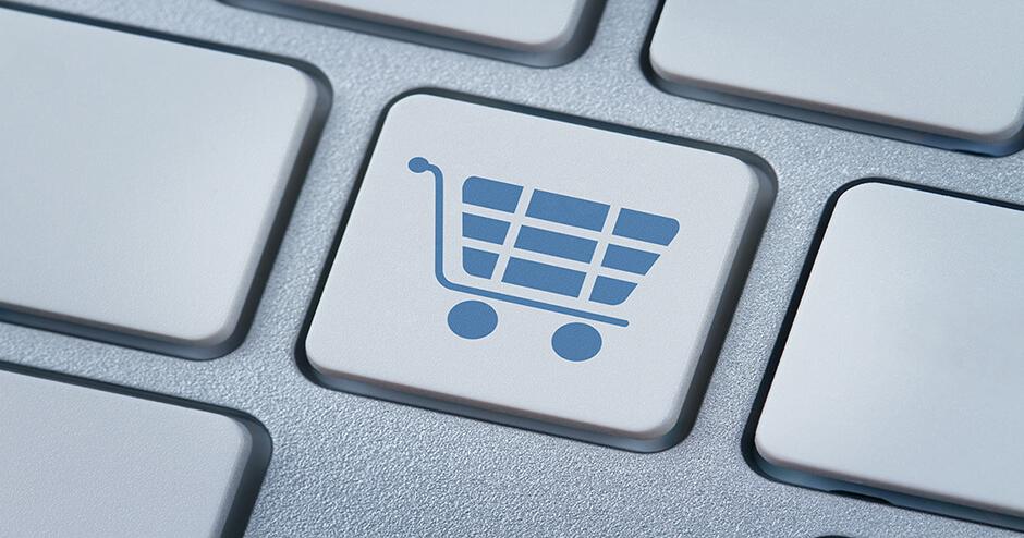 imagem de uma tecla de computador com o símbolo de carrinho de compras