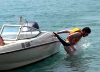 example of an accident: a man's swimmers get caught as he slides off boat