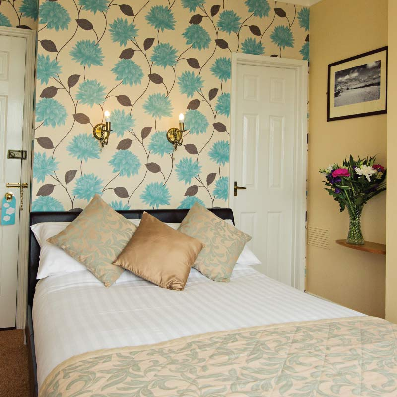 Double room with flowers at the Cliftonville Hotel, Cromer, Norfolk