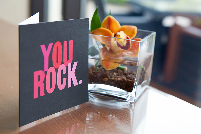 photo of greeting card saying 'You Rock' on a coffee table