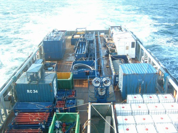 photo of offshore supply vessel with deck cargo