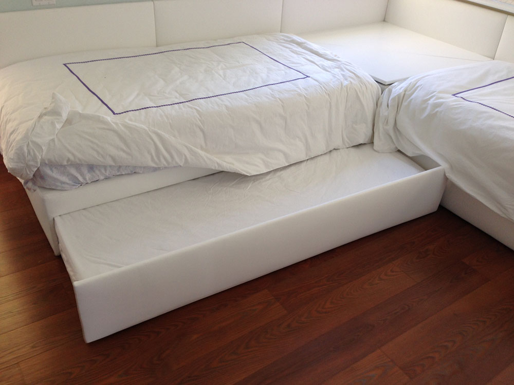 Leather Wrapped Twin Beds With Trundle And Corner Storage