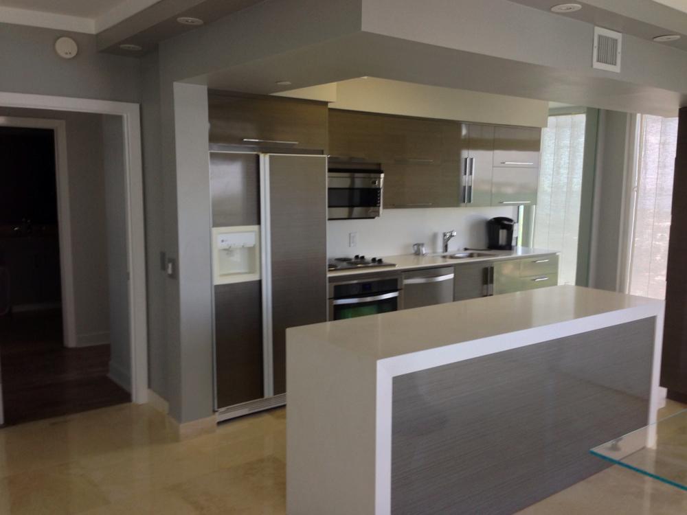 High Gloss Obeche Veneer Kitchen