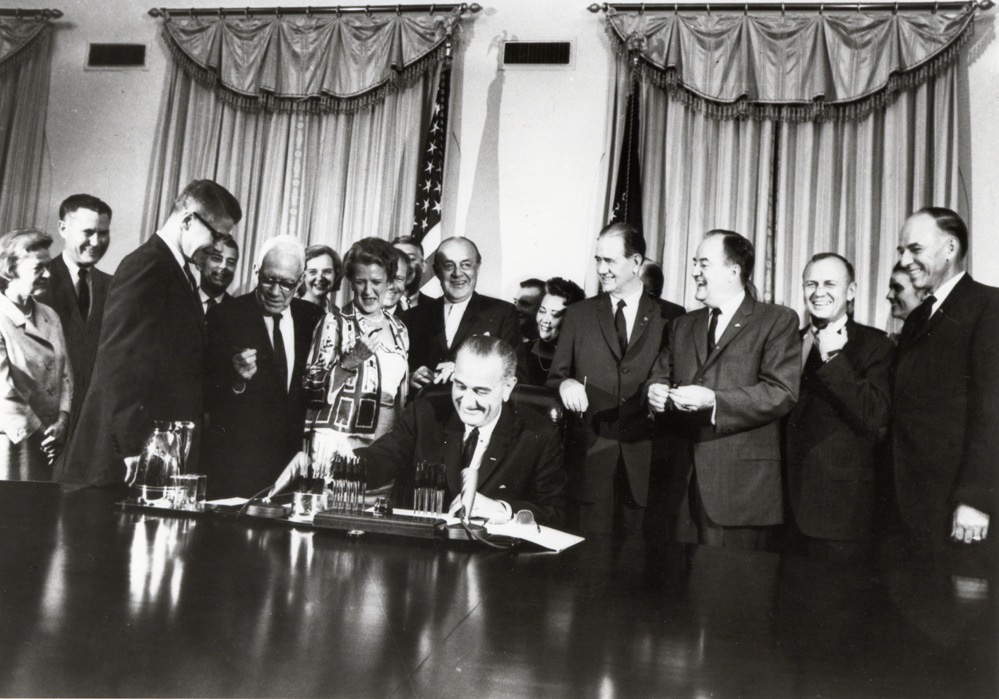 U.S. President Lyndon B. Johnson signing the Food Stamp Act of 1964.