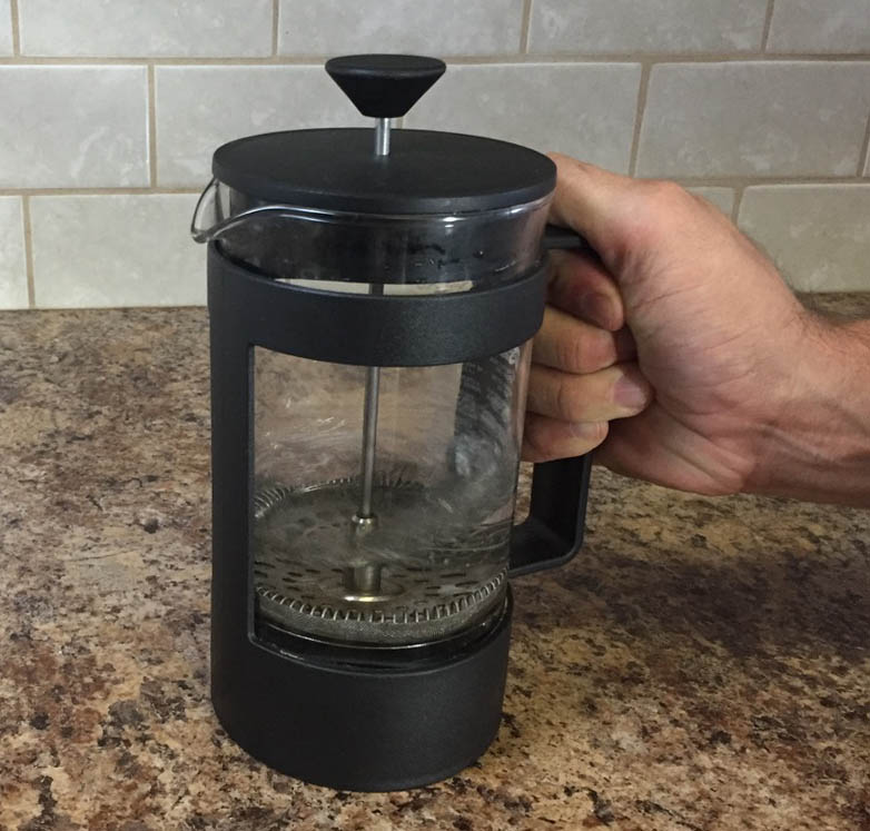 Preheat French press beaker with hot water