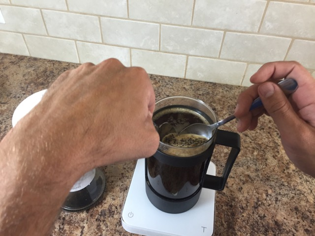 scoop the grounds off the top of the french press