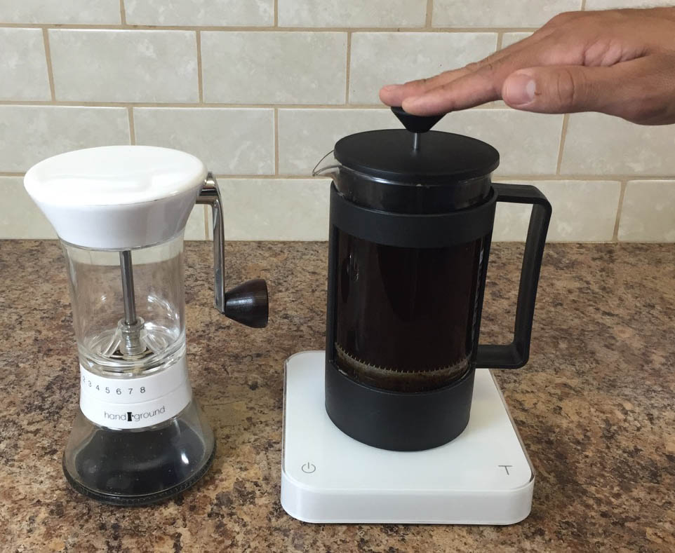 Pressing the plunger on a French Press