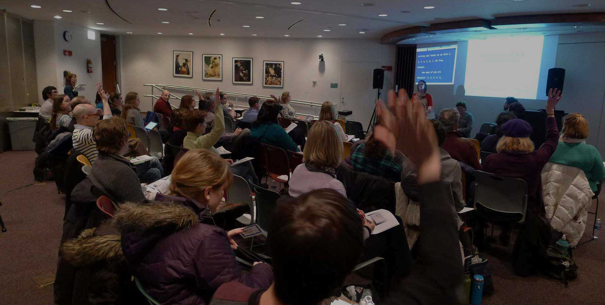 Photo of people attending accessibility seminar.
