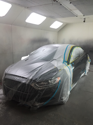 vehicle being painted in the car collision center