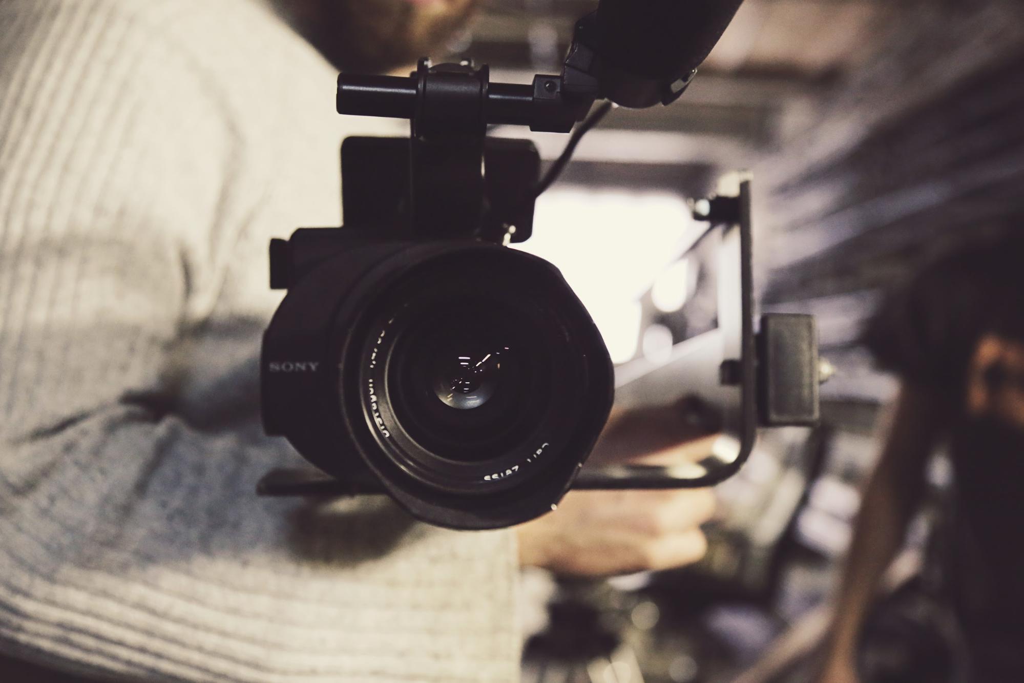 Videographer holding camera