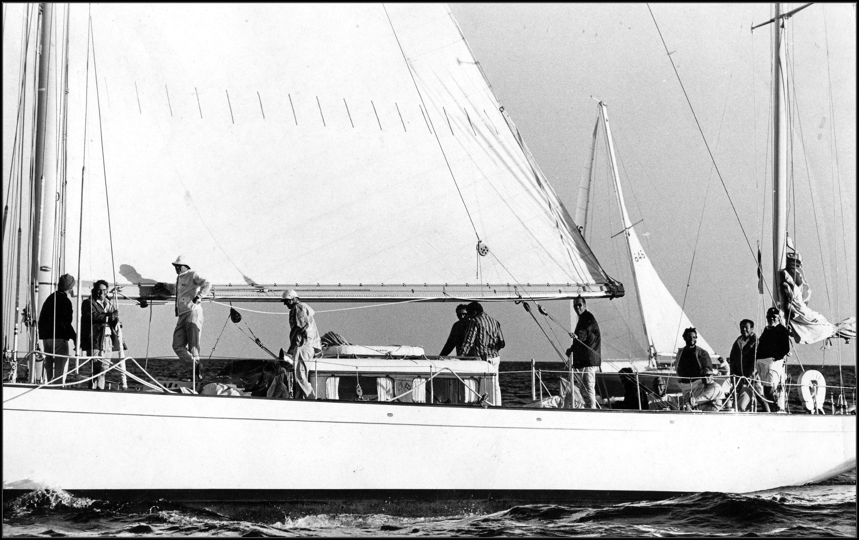 A broadside photo of sailboat Windigo under sail with crew