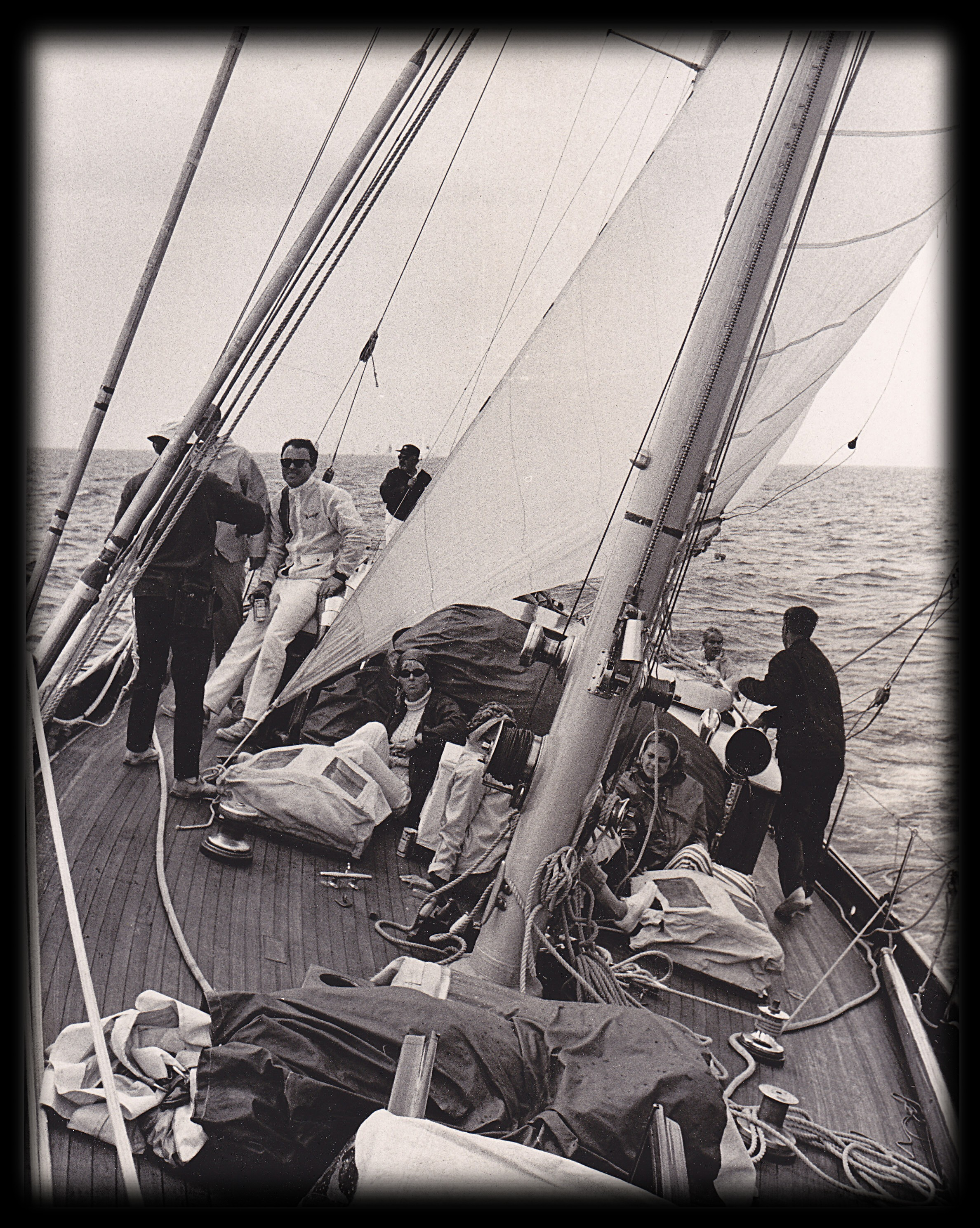 Photo of sailboat Windigo heeling over with crew on the deck.