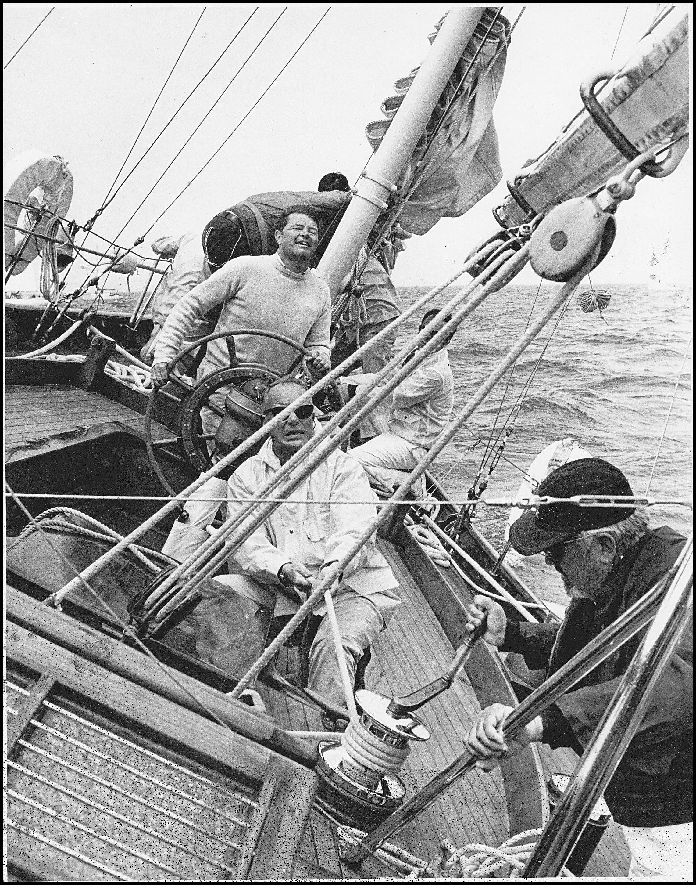 photo of sailboat Windigo with B. Lowry at the helm and C. Bissell operating the winch.