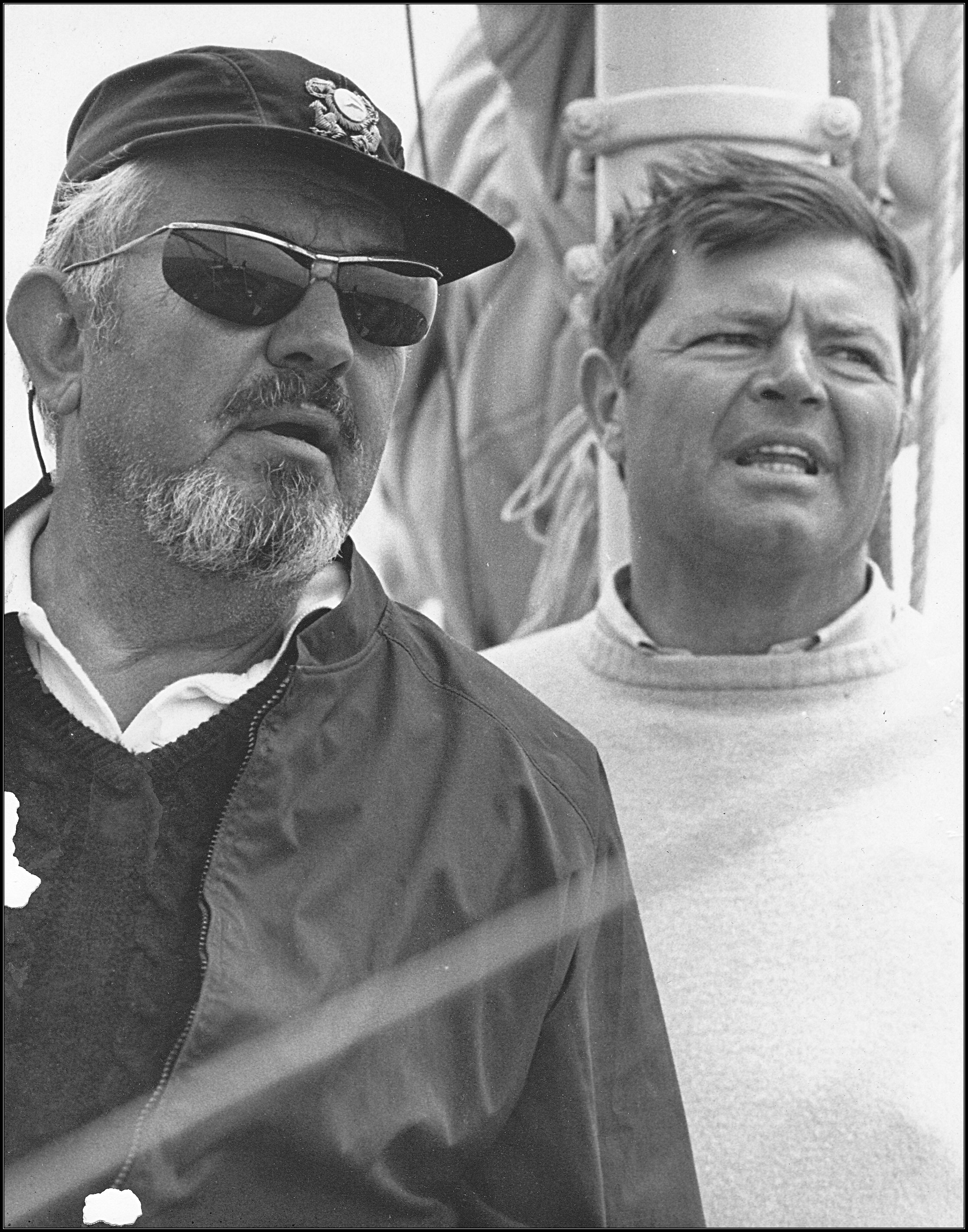 C. Bissell and B. Lowry on board sailboat Windigo.