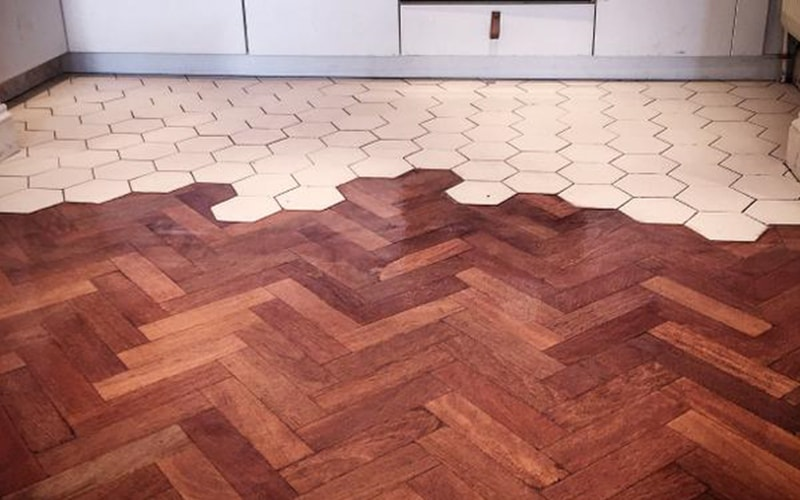 Herringbone parquet flooring and tiling combined together