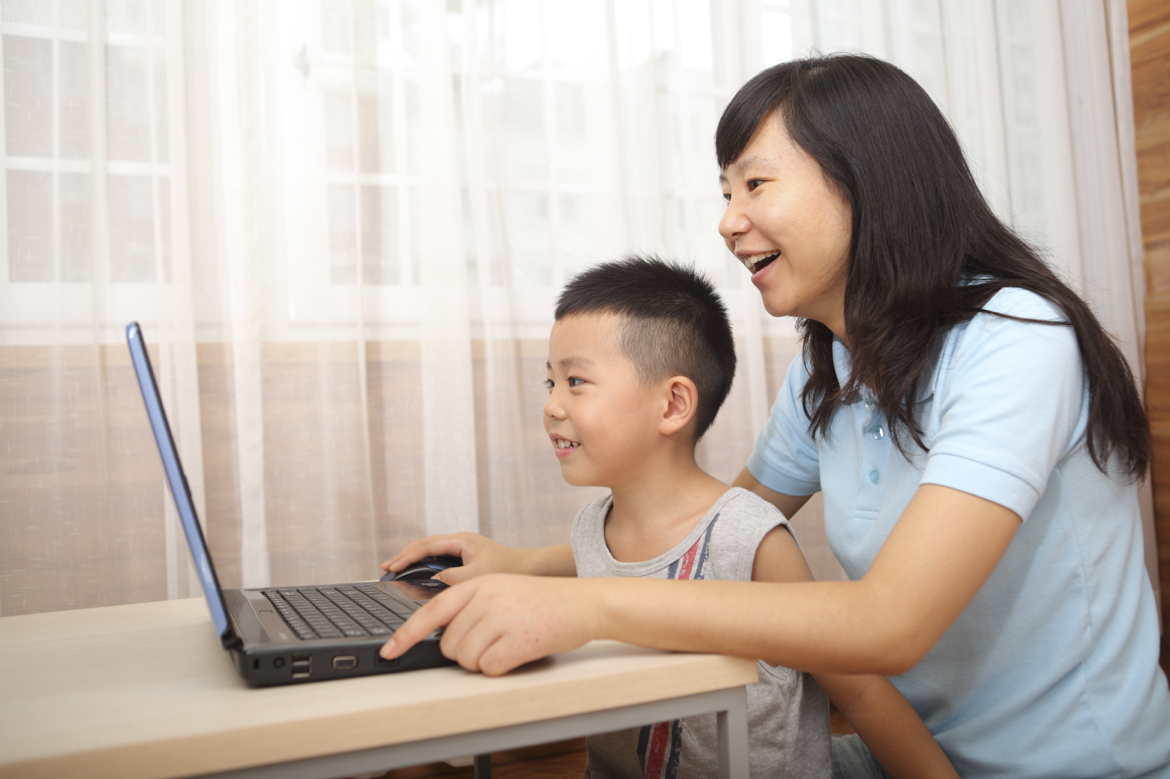 Mother and child on laptop