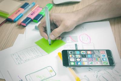 Mobile responsive design mock up drawn on paper.