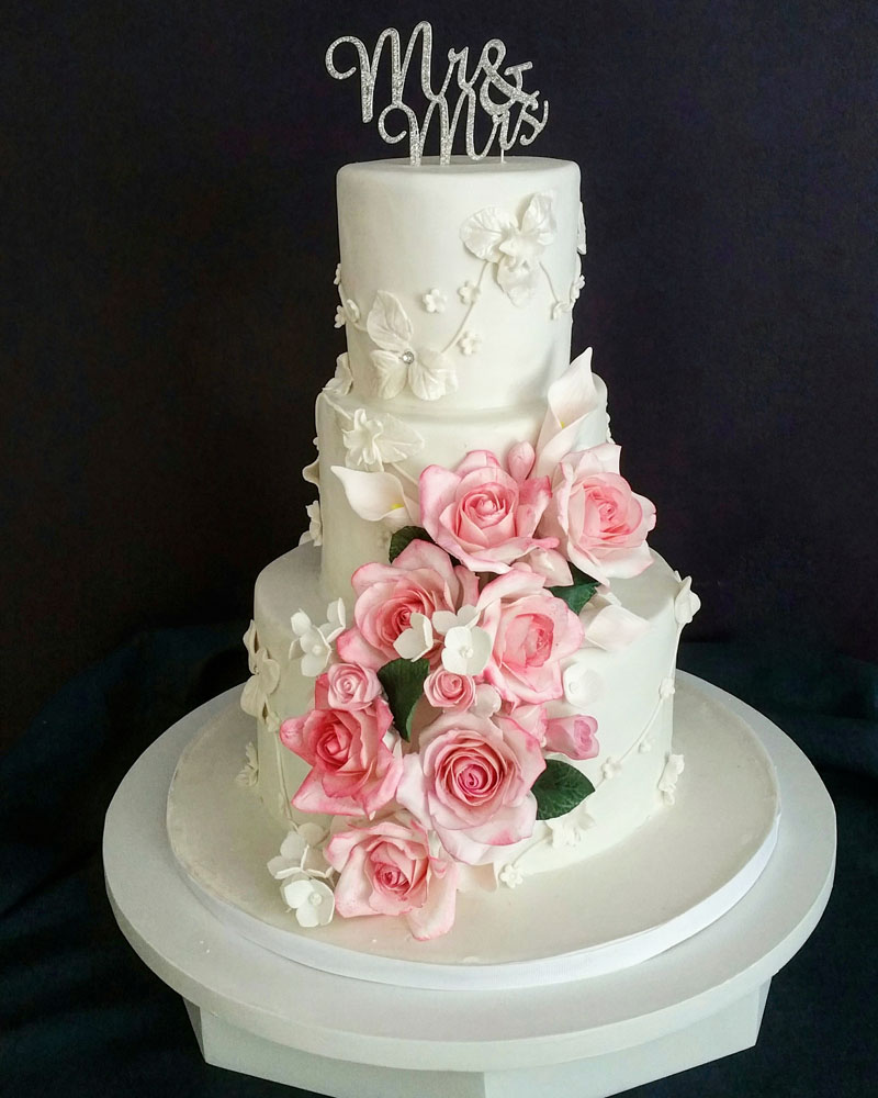 Intricate wedding cake by My Daughter's Cakes Dumont NJ
