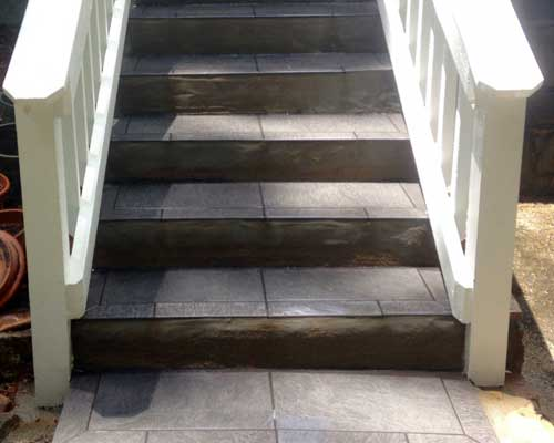 Tiled stairs after pressure washing.