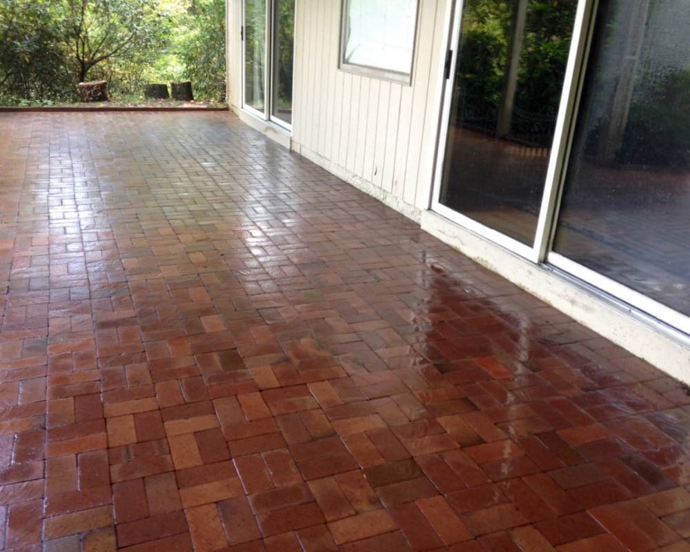 Back patio in Brevard after being pressure washed clean