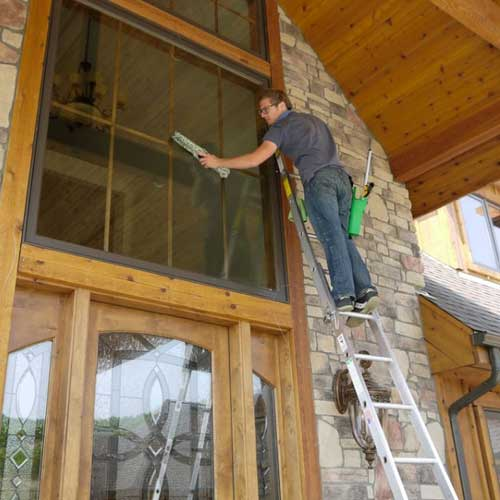 Home in Castle Rock getting windows cleaned.