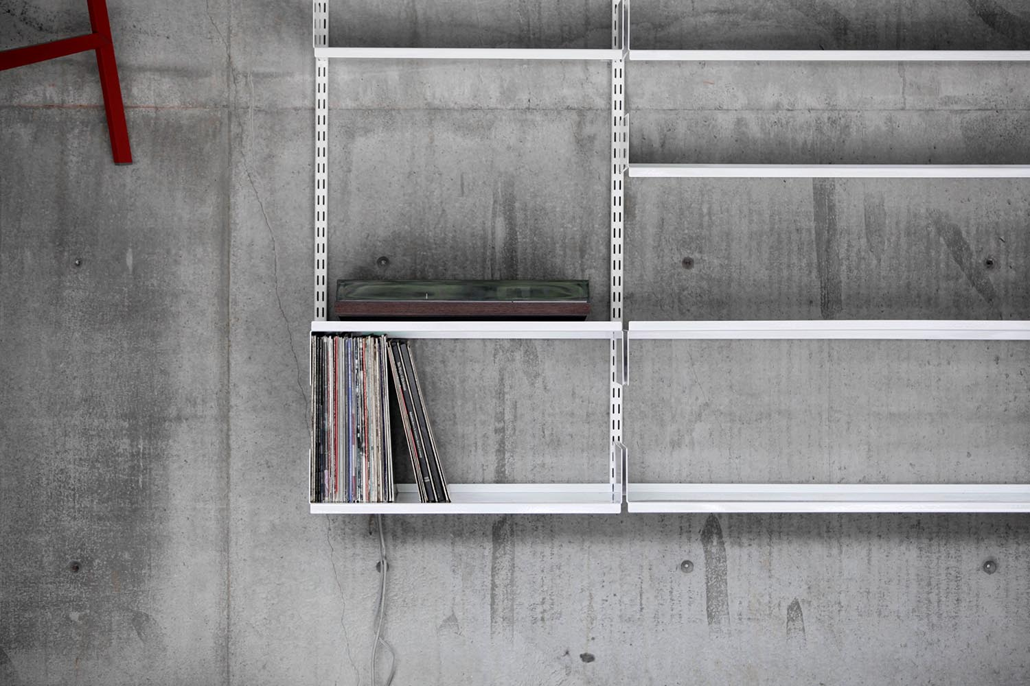 Photo of modular shelving design with record storage and record player