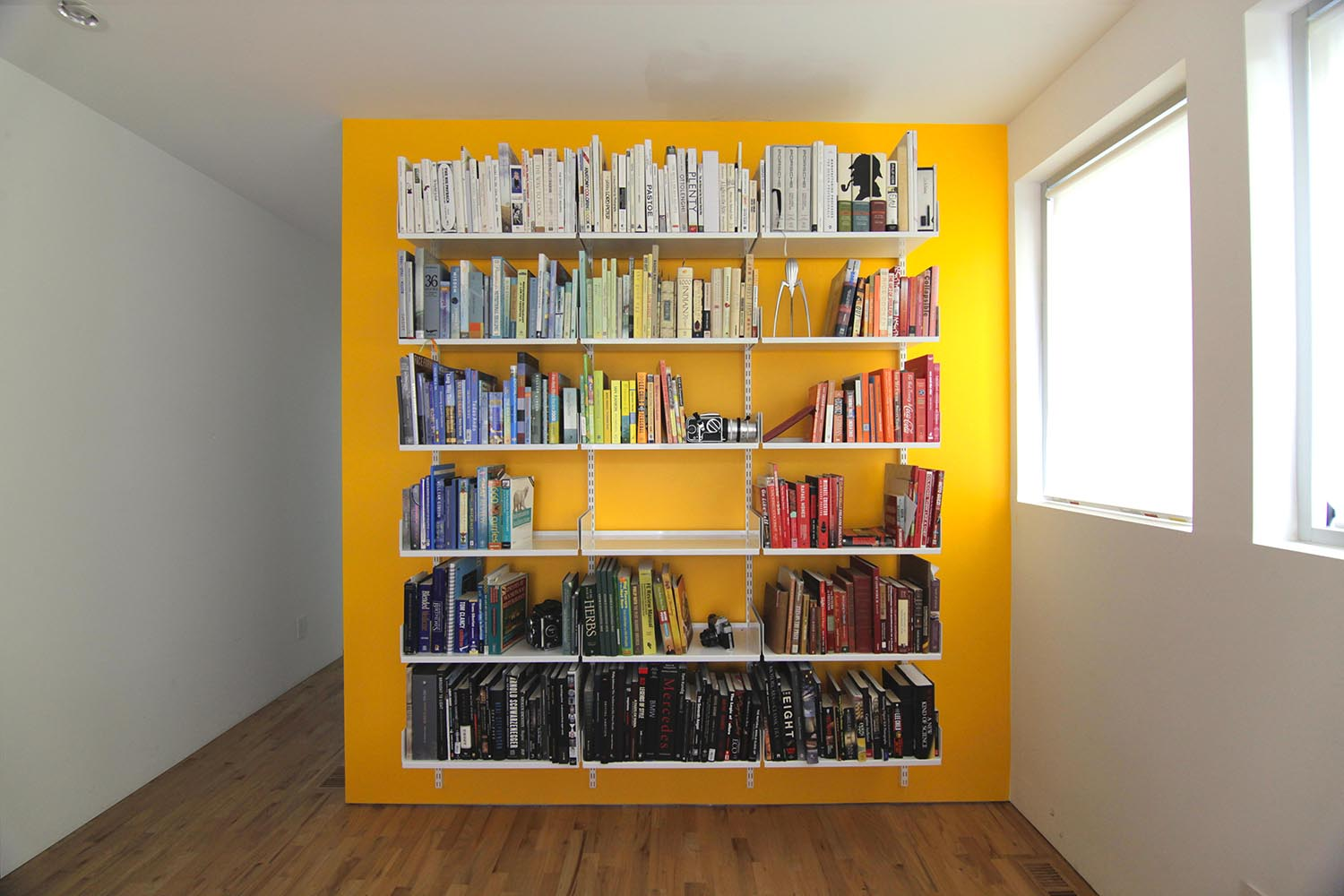 Photo of modular shelving design interior bedroom color coded