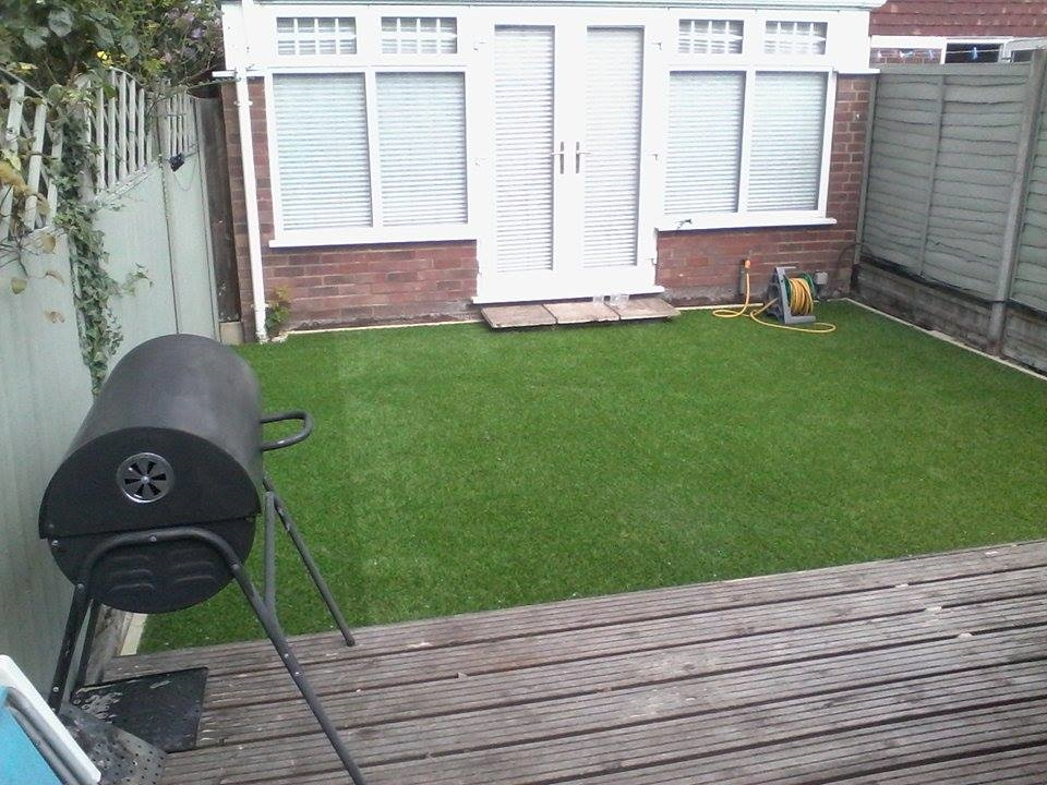 Fake grass installers north london creative scapes for Garden decking north london