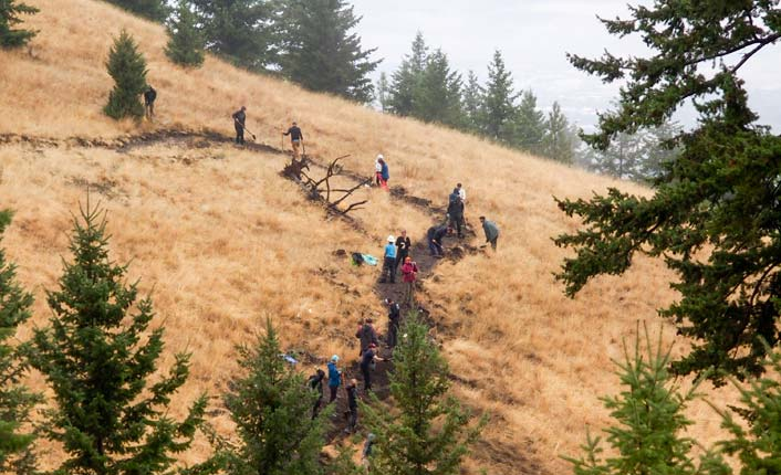 Volunteers working on the Barmeyer Loop Trail (top and bottom). Photos by LJ Dawson.