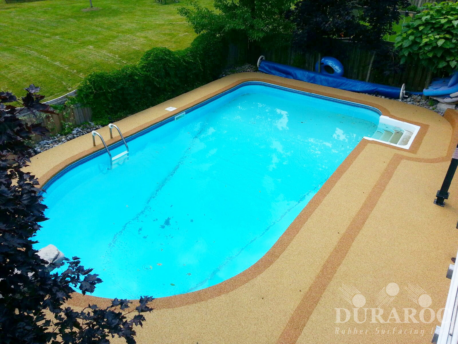 Outside pool with Duraroc rubber surfacing