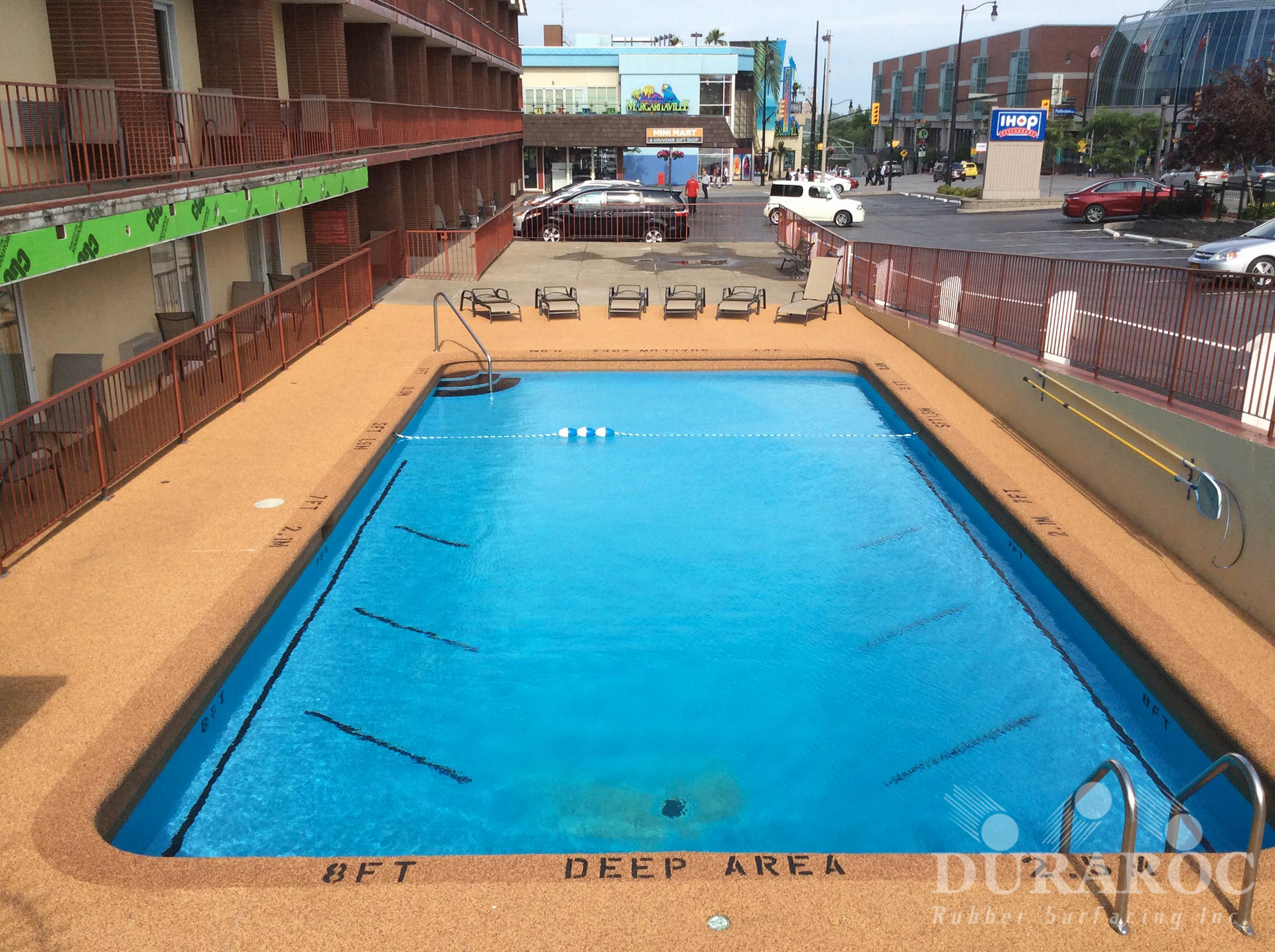 Outdoor pool Duraroc rubber coating