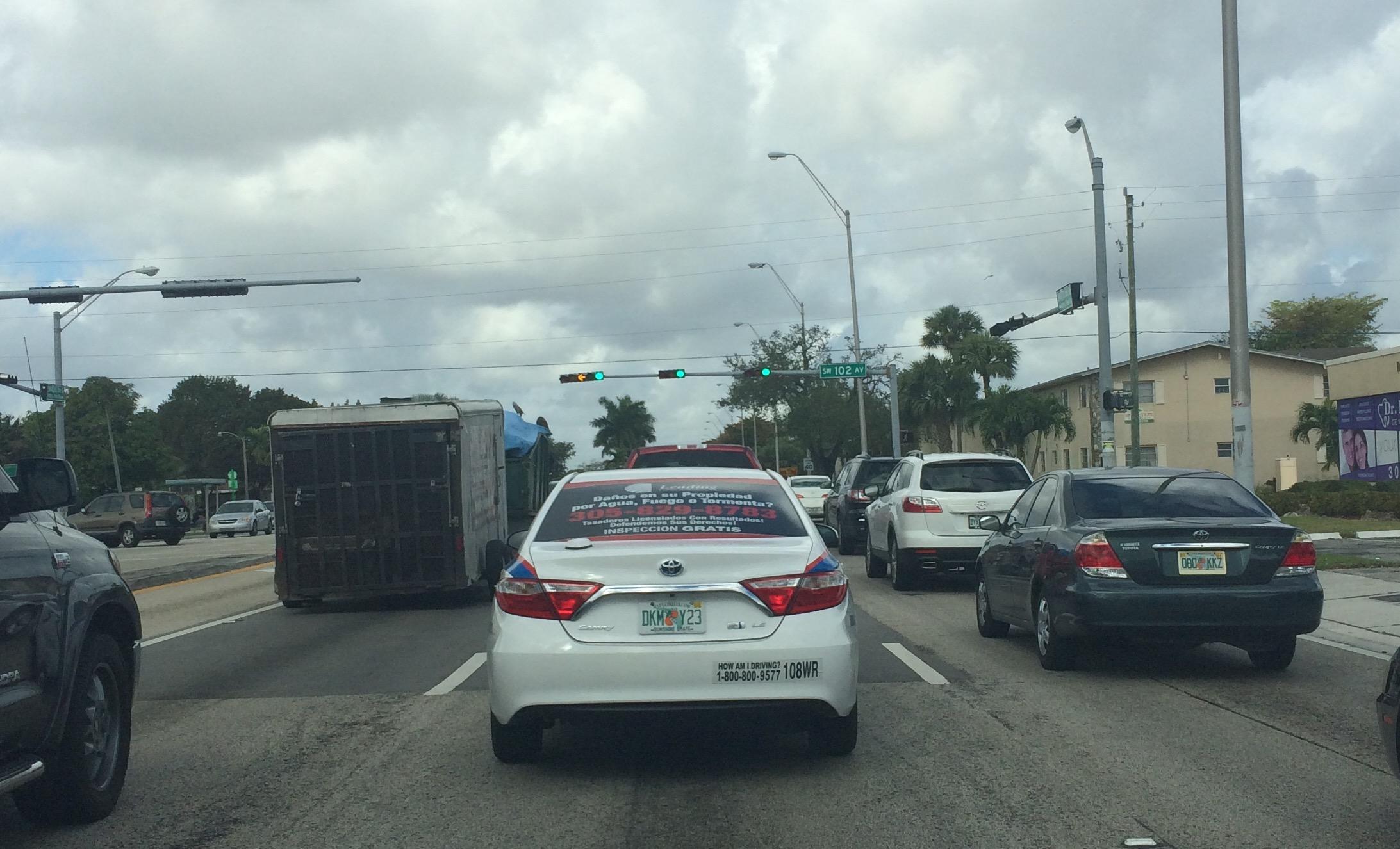 Photo of Leading Public Adjusters Ad on a Sedan Window