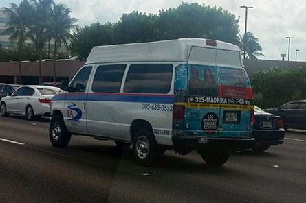 Del Toro Insurance back wrap on a Transportation America shuttle