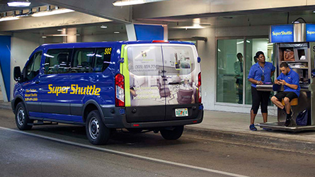 Habitat Residence Hotel Condo Back Wrap Ad on a SuperShuttle van