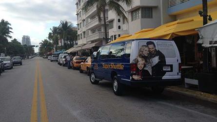 Simon Malls Shuttle Back Wrap on a SuperShuttle van seen at Ocean Drive