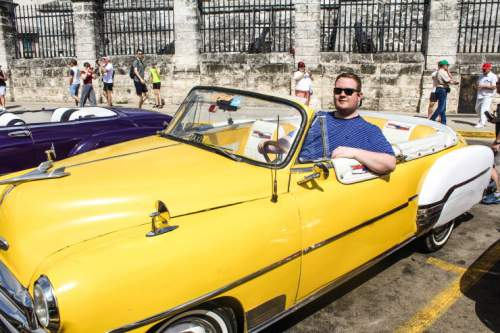 blog-Everything-You-Need-to-Know-to-Visit-Havana-Cuba-sitting-in-classic-car.jpg