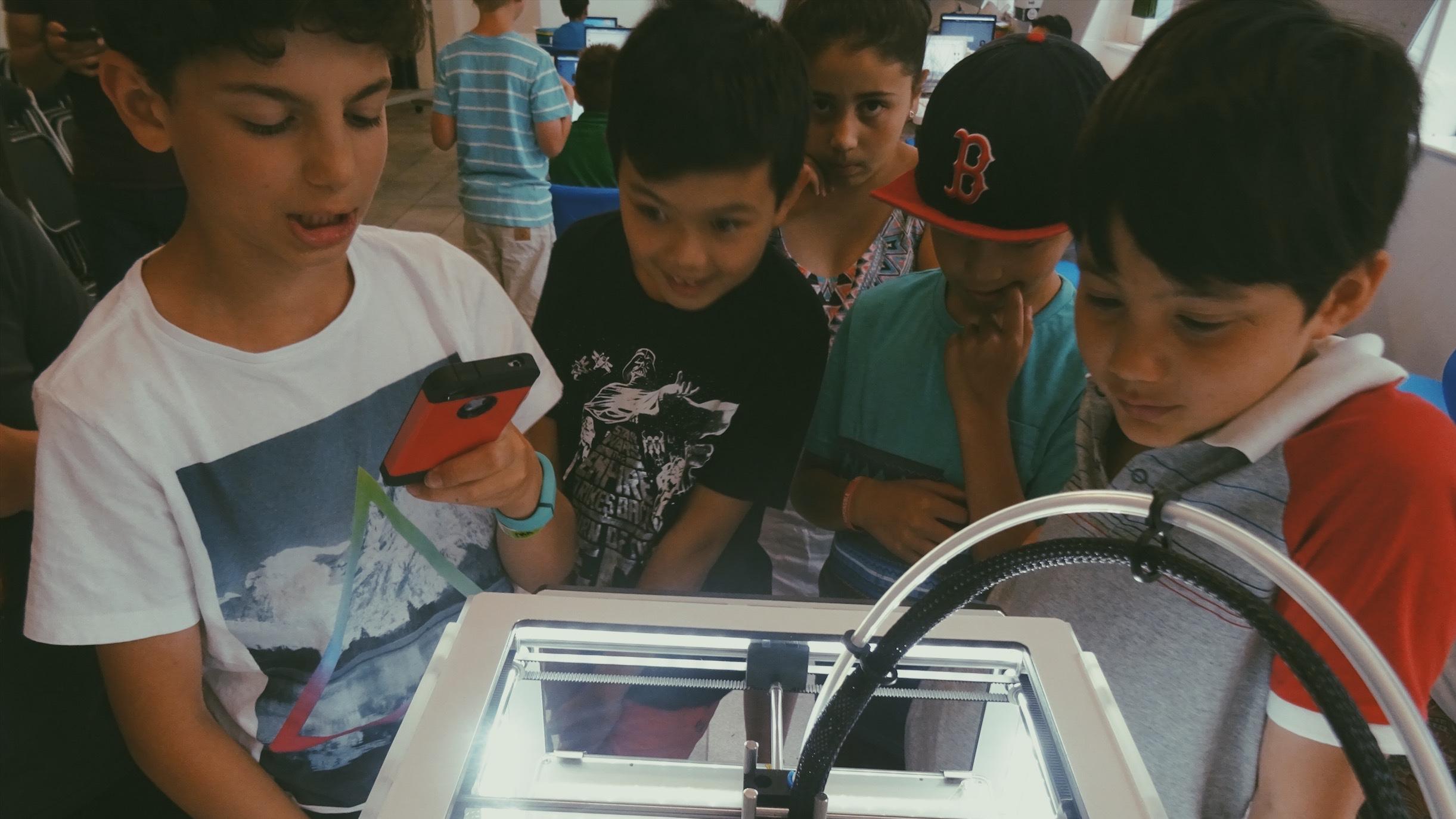 Lemonade Stand Kids AR: kids looking at a 3D printer