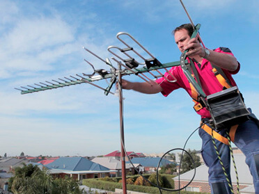 Picture of a man installing a TV aerial