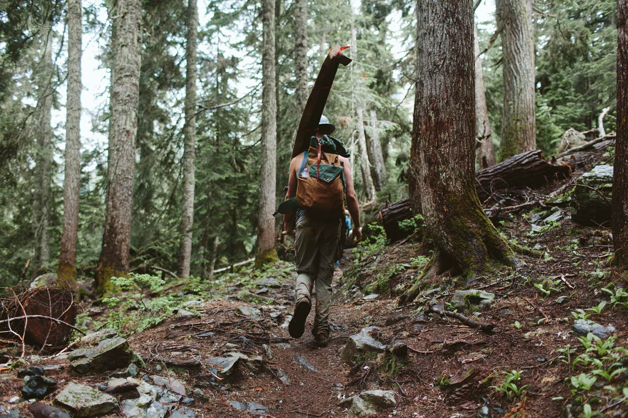 Uphill volunteer hiking with crosscut saw