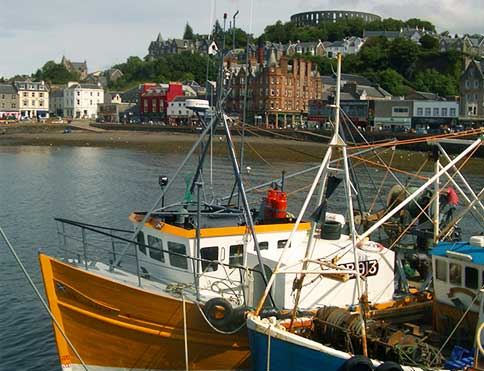 Oban's busy harbour, looking over to McCaig's Tower