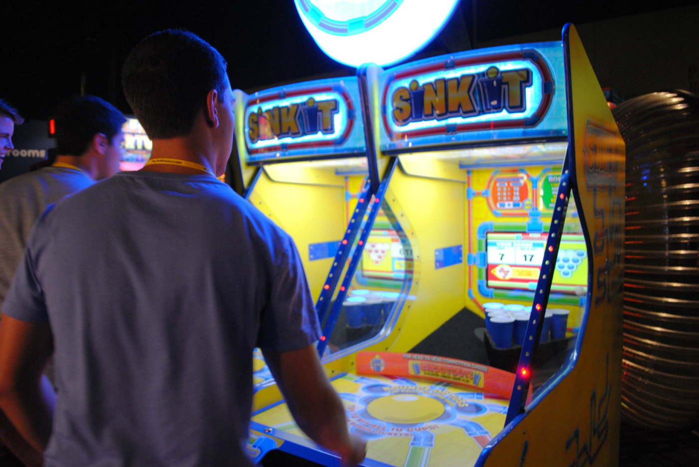 Image of people playing arcade games at Big Thrill Factory arcade