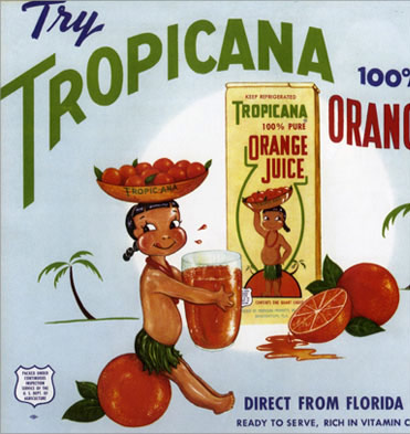 Tropic Ana, a girl wearing a grass skirt and a lei sitting on an orange.