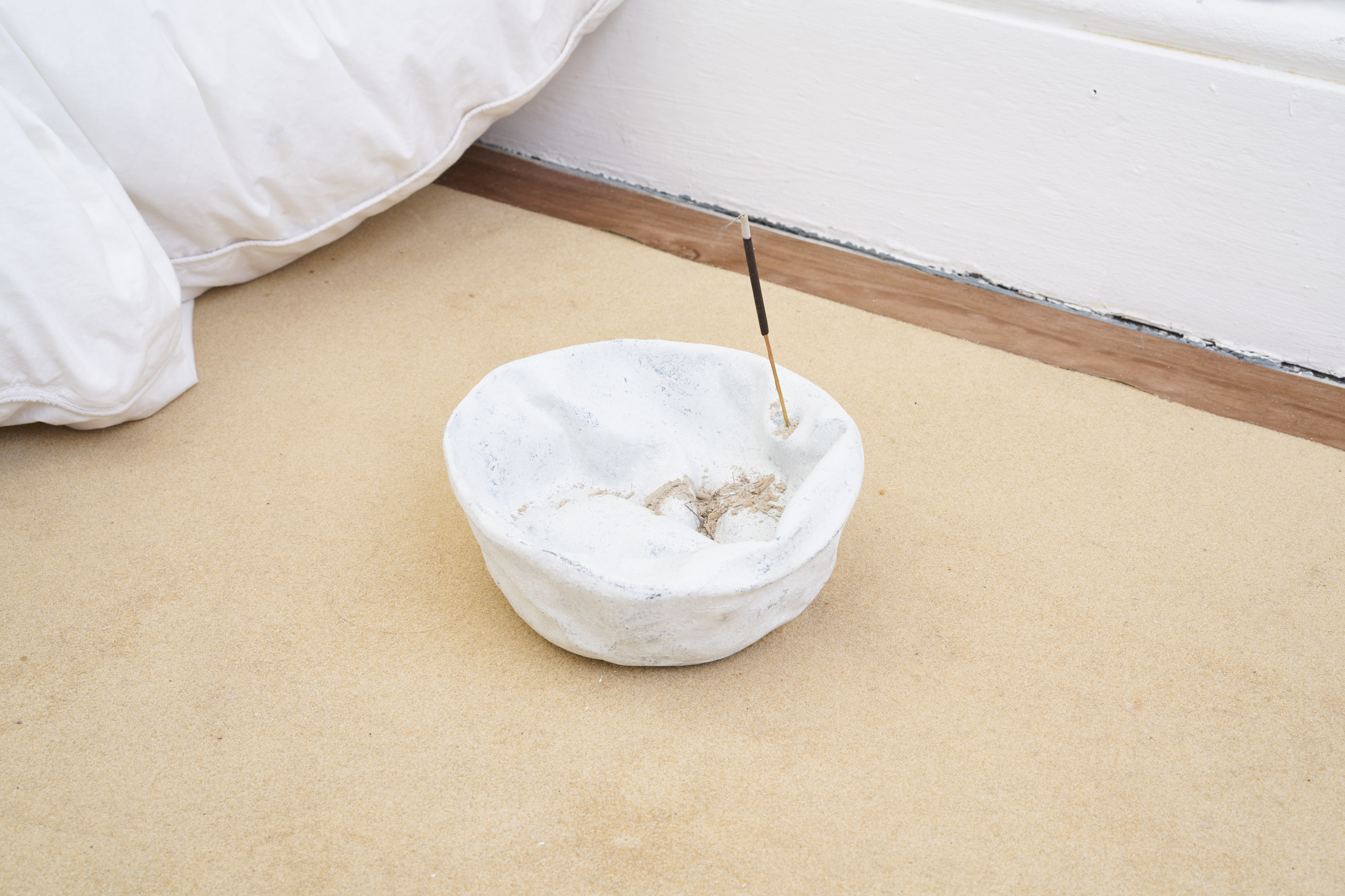 Andrea Zucchini, Microcosm, 2016. Detail. Duvet, cast bronze seeds and incense bowl. Tenderpixel.