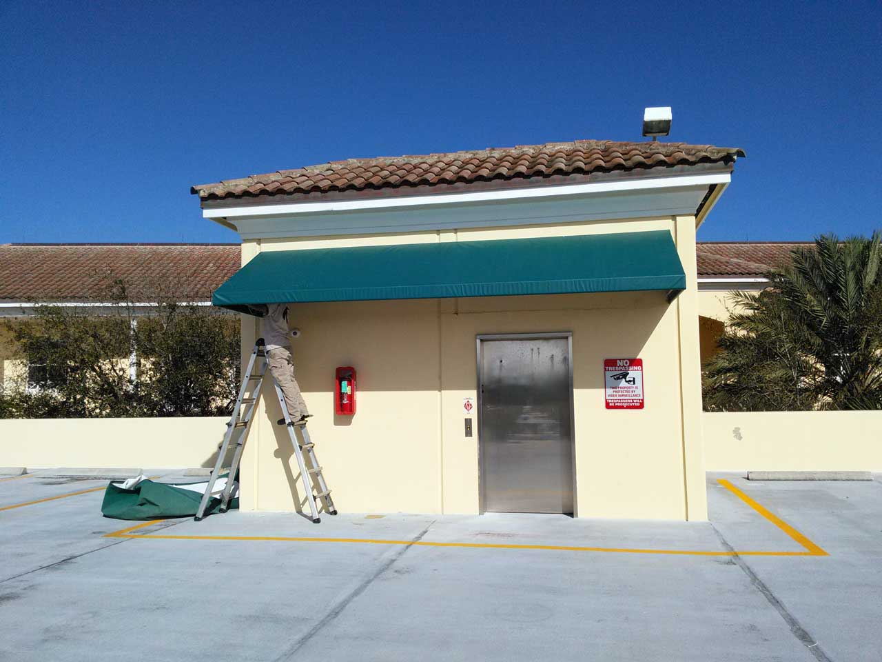 Roof access awning