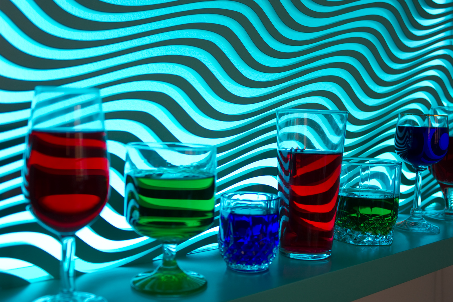David Ferrando Giraut, V.2 - Campari, Peppermint, Curaçao (Confessional), 2015. (Detail.) From the series Vortex. Lacquered MDF and wood, LED lights, programmer, glasses, Campari, Peppermint, Curaçao.